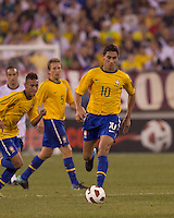 Brazil midfielder Paulo Henrique Ganso (10) brings the ball forward. Brazil  defeated the US men's national team, 2-0, in a friendly at Meadowlands Stadium on August 10, 2010.