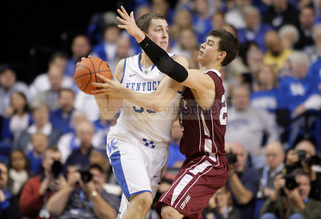 UK forward Kyle Wiltjer looks to pass the ball against Lafayette forward Alan Flannigan during the first half of the UK men's basketball game vs. Lafayette at Rupp Arena in Lexington, Ky., on Friday, November 16, 2012. Photo by Tessa Lighty   Staff