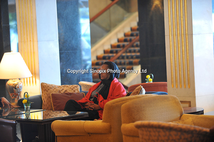 Grace Mugabe with red scarf and glasses,  (subject to identification) and friend in Hong Kong's, Kowloon 15th Jan 2005.<br /> <br /> photo &copy;&nbsp;by Sinopix