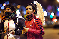 Runners passing by the Cibeles Square during the San Silvestre Running Race 2012 in Madrid
