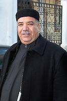 Tripoli Medina, Libya - Eid al-Adha, Id al-Adha.  Libyan Man Wears Traditional Heavy Coat, Kaboot, After Eid Prayers, plus Black Tunisian Hat, a Chechia.