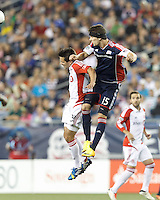 Toronto FC forward Andrew Wiedeman (32) and New England Revolution defender Stephen McCarthy (15) battle for head ball.  In a Major League Soccer (MLS) match, Toronto FC (white/red) defeated the New England Revolution (blue), 1-0, at Gillette Stadium on August 4, 2013.