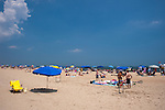 An empty chair near an umbrella mark the territory of a summer visitor to Rehoboth Beach, Delaware, USA.