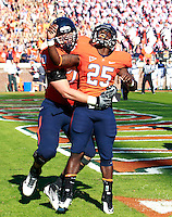 Oct. 15, 2011-Charlottesville, VA.-USA-  Virginia Cavaliers running back Kevin Parks (25) celebrates a 1st quarter touchdown with Virginia Cavaliers defensive tackle Greg Gallop (70) during the ACC football game against Georgia Tech at Scott Stadium. Virginia won 24-21. (Credit Image: © Andrew Shurtleff