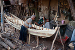 NAJAF, IRAQ: A master and his apprentice build a boat in the Najaf market...Daily life continues in relative peace in the Iraqi city of Najaf...Photo by Ali Arkady/Metrography
