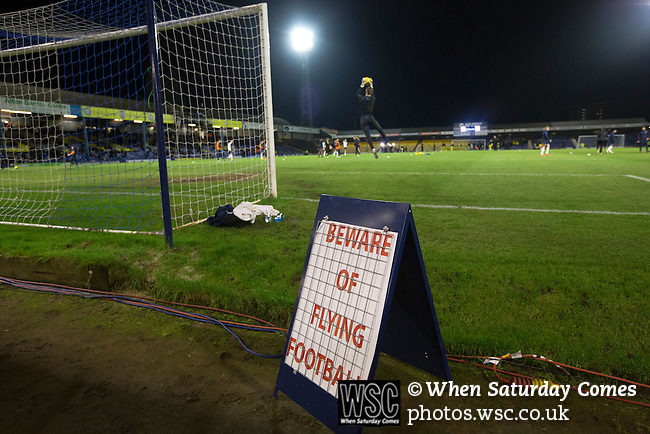 Southend United 1 Burton Albion 1, 22/02/2016. Roots Hall, League One. A sign warning spectators to beware of flying footballs, placed at the edge of the pitch during the teams' pre-match warm-up at Roots Hall stadium, before Southend United took on Burton Albion in a League 1 fixture. Founded in 1906, Southend United moved into their current ground in 1955, the construction of which was funded by the club's supporters. Southend won this match by 3-1, watched by a crowd of 6503. Photo by Colin McPherson.