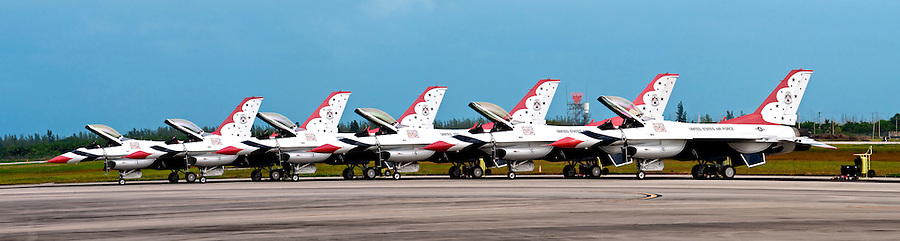 HOMESTEAD, FL - NOVEMBER 8, 2009: Thunderbirds Pilots walking in front of their F-16 jets on tarmac at Wings over Homestead Airshow. 8, 2009: Thunderbirds Pilots walking in front of their F-16 jets on tarmac at Wings over Homestead Airshow., FL - November 8, 2009:  SNJ-5 demonstration at Wings over Homestead Airshow, The SNJ-5 was the Navy's advanced trainer aircraft from 1936 through the 1940s and a primary trainer in the 1950s.  SNJ-5 demonstration at Wings over Homestead Airshow, The SNJ-5 was the Navy's advanced trainer aircraft from 1936 through the 1940s and a primary trainer in the 1950s. 8, 2009: Thunderbirds Pilots walking in front of their F-16 jets on tarmac at Wings over Homestead Airshow. 8, 2009: Panoramic image of USAF Thunderbirds F-16 jets on tarmac at Wings over Homestead Airshow, November 8, 2009, Homestead Airbase, Homstead, Florida