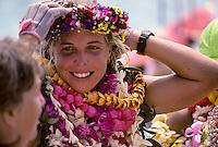 Outrigger canoe racing; paddler, Katie McCreary of Outrigger Canoe Club, at finish of Women's Molokai to Oahu Race, October 1989, Kahanamoku Beach, Waikiki, Oahu