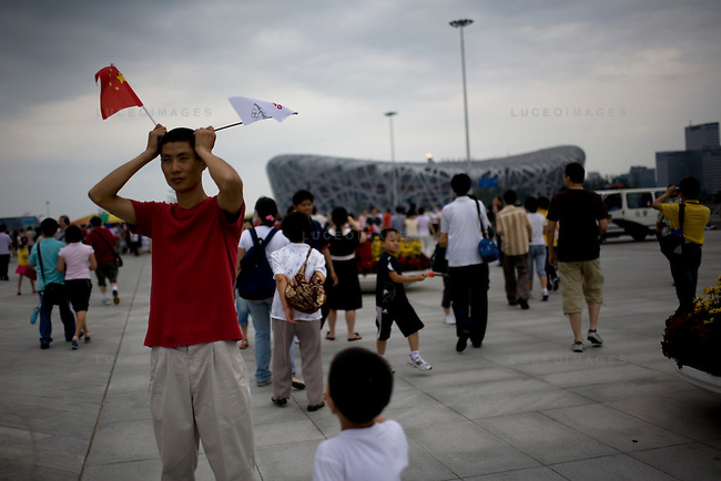 Locals pose for photos in front of the National Stadium outside the security area in Beijing, China on Sunday, August 17, 2008.  Kevin German