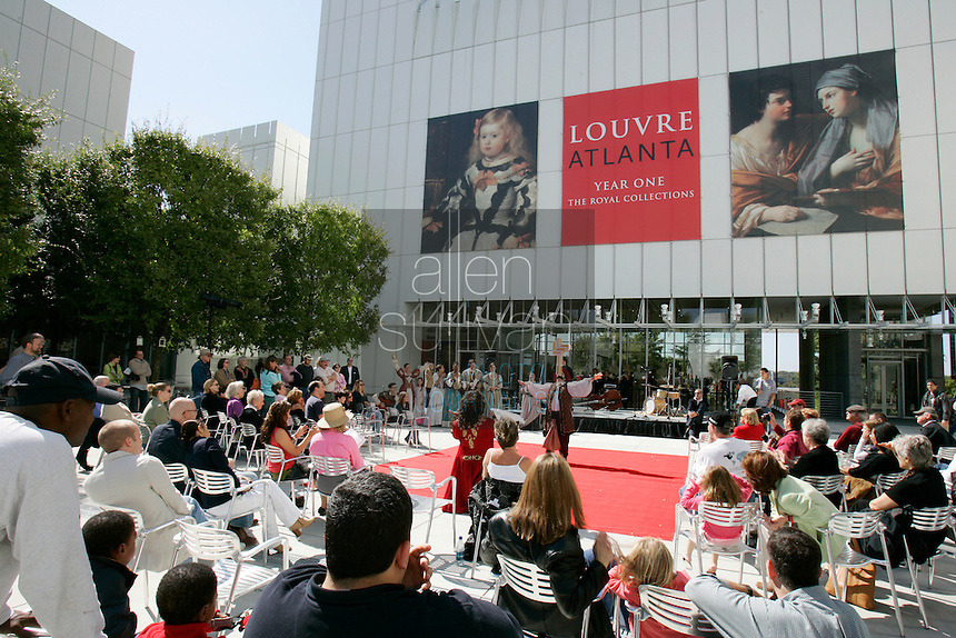 Members of the French-language troupe Théâtre du Rêve entertain people during the pubic opening of Louvre Atlanta at the High Museum of Art. Over the next three years, the High Museum will feature hundreds of works of art from the Musée du Louvre in Paris.