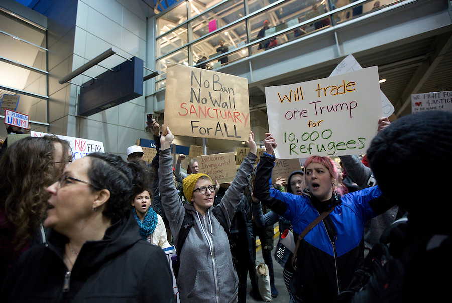 Protesters at a rally at Portland International Airport January 29, 2017. The demonstrators oppose President Donald Trump's travel ban that blocks citizens of seven majority Muslim nations from entering into the U.S.. Photo by Natalie Behring