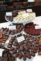 Puccini Bomboni chocolate shop selling exotic flavour chocolates in stylish display as treats in Old Town Amsterdam, Holland