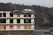 A car still sits atop a roof of a building, washed there by the 2011 tsunami, on the 1 year anniversary of the March 11th 2011 earthquake and tsunami, in Minami-Sanriku, Tohoku region, Japan on Sunday 11th March 2012.