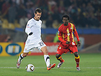 Benny Feilhaber of USA and Anthony Annan of Ghana. Ghana defeated the USA 2-1 in overtime in the 2010 FIFA World Cup at Royal Bafokeng Stadium in Rustenburg, South Africa on June 26, 2010.