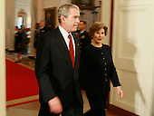 Washington, DC - November 17, 2008 -- United States President George W. Bush and first lady Laura Bush arrive at an event in the East Room at the White House on Monday, November 17, 2008 in Washington, DC. During the event president Bush presented recipients with awards for the National Medals of Arts and the National Humanities Medal.  .Credit: Mark Wilson - Pool via CNP