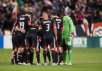 D.C. United assistant coach Chad Ashton talks to his starting players at halftime during the game at RFK Stadium in Washington,DC. D.C. United tied the Houston Dynamo, 1-1.  With the tie, Houston won the Eastern Conference and advanced to the MLS Cup.