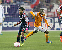 New England Revolution midfielder Lee Nguyen (24) gets ready to pass the ball as Houston Dynamo midfielder Oscar Boniek Garcia (27) come around to tackle.  The New England Revolution played to a 1-1 draw against the Houston Dynamo during a Major League Soccer (MLS) match at Gillette Stadium in Foxborough, MA on September 28, 2013.