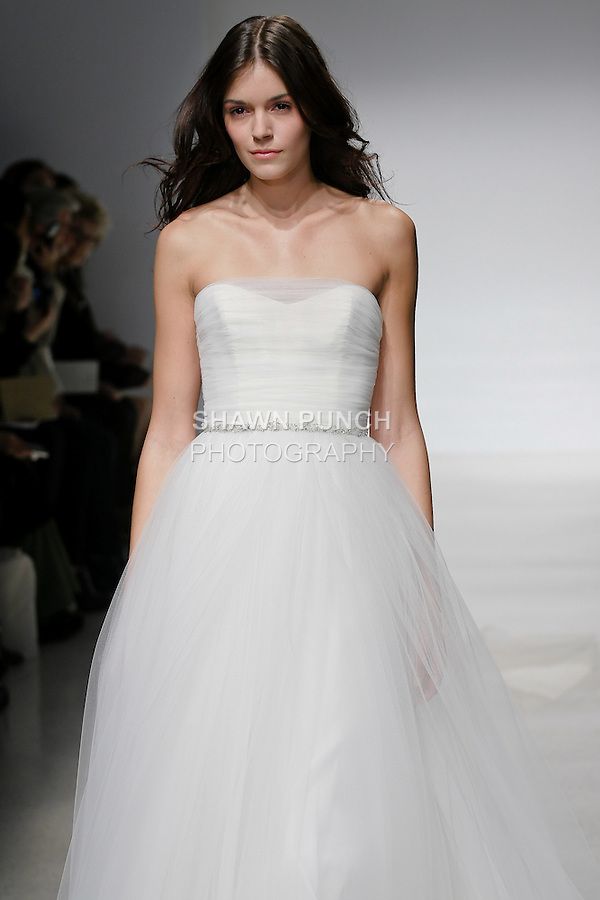 Model walks runway in a Myrna wedding dress by Amsale Aberra, for the Christos Spring 2012 Bridal runway show.