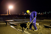 BAGHDAD, IRAQ: Mustafa Abdulraza (22) works at the Midland Oil Company field.