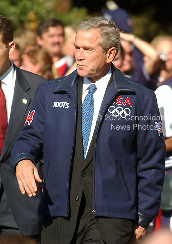 United States President George W. Bush, wearing his new olympic team warm-up jacket, greets members of the 2004 United States Olympic and Paralympic teams on the South Lawn of the White House in Washington, D.C. on October 18, 2004.  <br /> Credit: Ron Sachs / CNP
