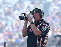 Oct 16, 2015; Ennis, TX, USA; Bob Wilber a crew member for NHRA funny car driver Tim Wilkerson during qualifying for the Fall Nationals at the Texas Motorplex. Mandatory Credit: Mark J. Rebilas-USA TODAY Sports