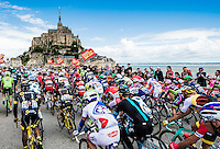 Picture by Alex Broadway/ASO/SWpix.com - 02/07/2016 - Cycling - Tour de France 2016 - Stage One - Mont-Saint-Michel to Utah Beach Sainte-Marie-du-Mont - The peloton passes Mont-Saint-Michel.<br /> NOTE : FOR EDITORIAL USE ONLY. COMMERCIAL ENQUIRIES IN THE FIRST INSTANCE TO simon@swpix.com THIS IS A COPYRIGHT PICTURE OF ASO. A MANDATORY CREDIT IS REQUIRED WHEN USED WITH NO EXCEPTIONS to ASO/ALEX BROADWAY