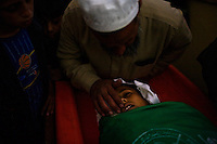 Rafah, Gaza Strip, Jan 16 2009.Mohammed Ayat Al Armilat, 50, during the funeral of his son Aissa Mohammed Armilat, 12, who was in the garden in front of his house in eastern Rafah at 7AM when an Israeli shell killed him on the spot. There was no fighting activity whatsoever in the area.