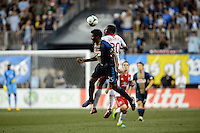 Sheanon Williams (25) of the Philadelphia Union goes up for a header with Jose Valencia (20) of the Portland Timbers. The Philadelphia Union and the Portland Timbers played to a 0-0 tie during a Major League Soccer (MLS) match at PPL Park in Chester, PA, on July 20, 2013.
