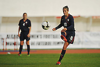 US midfielder Carli Lloyd passes the ball to a teammate during a 2010 Algarve Cup game vs Iceland in VIla Real Sto. Antonio, Portugal.