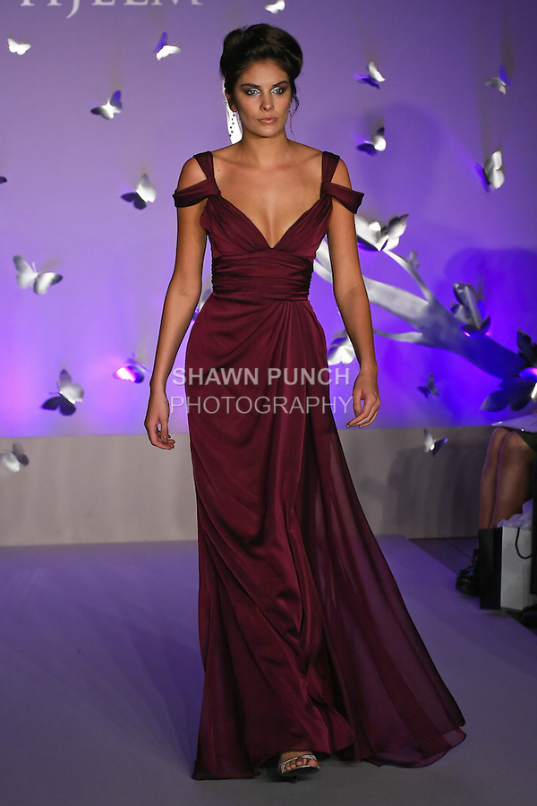 Model walks runway in a Jim Hjelm Fall 2011 dress by Francesca Pitera, for the JLM Couture Fall 2011 Bridal fashion show.