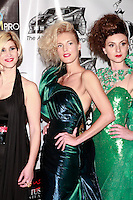 Models pose on the red carpet after the Amal Sarieddine Spring 2012 fashion show; at the Waldorf Astoria Hotel in New York City, during Couture Fashion Week, September 16, 2011.