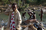 LUDZIDZINI, SWAZILAND - AUGUST 30: Young girls wash themselves in a river before a traditional Reed dance ceremony at the stadium at the Royal Palace on August 30, 2009, in Ludzidzini, Swaziland. About 80.000 virgins from all over the country attended this yearly event, which goes on for a week and the biggest in Swazi culture. It was founded to celebrate the beauty of Swazi women and girls. King Mswati III, and absolute monarch, was born in 1968 and he has 14 wives and many children. The king danced with his men in front of the 80.000 girls. Many of the girls hope to get noticed by the king and to be chosen as a future wife, a ticket from poverty and into a life of privilege and luxury. The country is one of the poorest in the world and it is struggling with a high prevalence of HIV-Aids and severe poverty. (Photo by: Per-Anders Pettersson)..