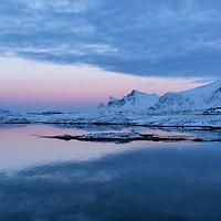 Winter twilight over mountain of Flakstadøy from Fredvang bridges, Lofoten Islands, Norway