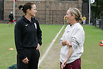 25 October 2009: Duke assistant coach Carla Overbeck (left) and Virginia Tech head coach Kelly Cagle (right). The Duke University Blue Devils defeated the Virginia Tech Hokies 4-1 at Koskinen Stadium in Durham, North Carolina in an NCAA Division I Women's college soccer game.