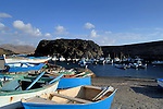 Rowing boats, fishing boats in the harbour at El Cotillo, Fuerteventura, Canary Islands, Spain.