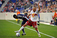 Joel Lindpere (20) of the New York Red Bulls and Michael Lahoud (11) of CD Chivas USA battle for the ball. CD Chivas USA defeated the New York Red Bulls 3-2 during a Major League Soccer (MLS) match at Red Bull Arena in Harrison, NJ, on May 15, 2011.
