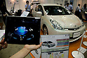 May 131, 2012, Tokyo, Japan - An exhibitor controls a movement of the car?s tire for her iPad. The Smart Grid Exhibition and Automotive Next Industry Fair 2012 shows the next generation of vehicles and manufacturing working with eco energy, from May 30th. to June 1st. at Tokyo Big Site. .