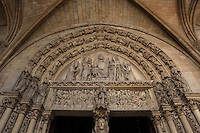Low angle view of the porch of the portal to the upper chapel, La Sainte-Chapelle (The Holy Chapel), 1248, Paris, France. The tympanum represents the Last Judgement. Christ in majesty is surrounded by angels holding torture instruments. On the lintel, angels call dead souls to rise from their graves. In the middle, Archangel Michael proceeds to the weighing of the souls while a devil is trying to cheat. La Sainte-Chapelle was commissioned by King Louis IX of France to house his collection of Passion Relics, including the Crown of Thorns. The Sainte-Chapelle is considered among the highest achievements of the Rayonnant period of Gothic architecture. Picture by Manuel Cohen