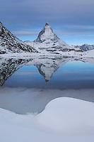 Matterhorn in winter with reflection in the Riffelsee, Zermatt, Valais, Switzerland