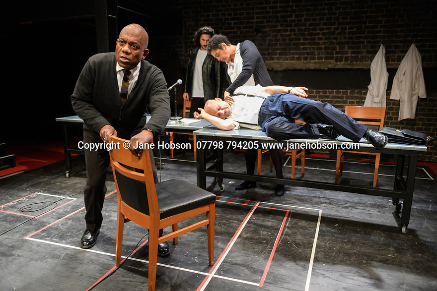 """London, UK. 10.04.2017. A brand new adaptation of Albert Camus' """"The Plague"""" opens at the Arcola Theatre. Adapted and directed by Neil Bartlett. Picture shows: Burt Caesar (Grand),  Billy Postlethwaite (Mr Rambert), Joe Alessi (Mr Cottard), Sara Powell (Dr Rieux). Photograph © Jane Hobson."""