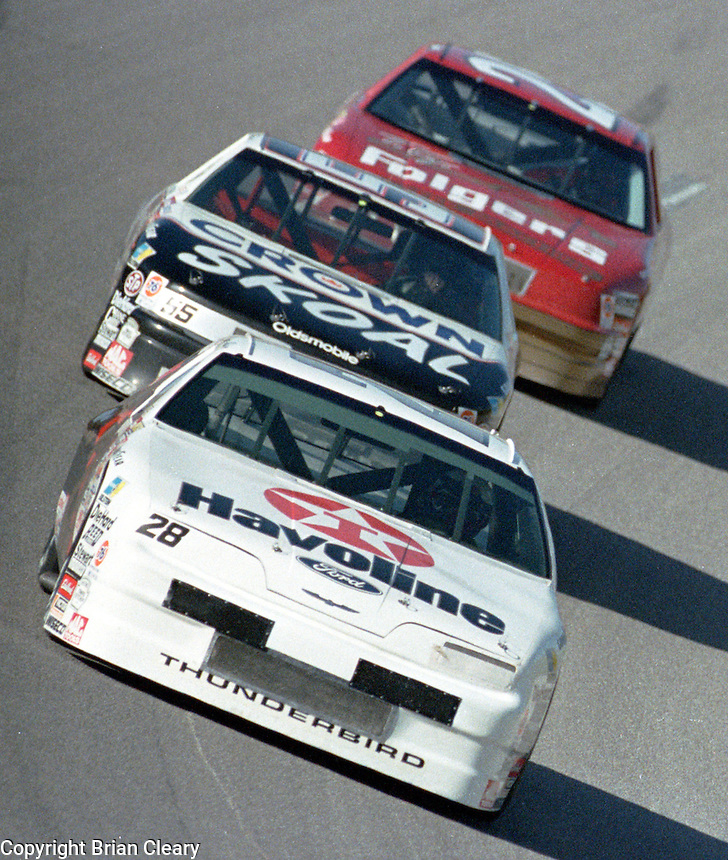 Davey Allison 28 Phil Parsons 55 Ken Schrader 25 action Winston 500 at Talladega Superspeedway in Talladega , AL in May 1989.  (Photo by Brian Cleary/www.bcpix.com)
