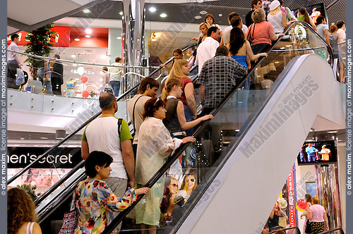 Stock photo of People on an escalator in a shopping mall in Kiev Ukraine Horizontal