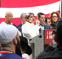NEW YORK, NY - FEBRUARY 19: A woman singing the National Anthem at the 'I Am Muslim Too' rally in Times Square coordinated by hip hop mogul Russell Simmons and a group of interfaith religious leaders in New York, New York on February 19, 2017.  Photo Credit: Rainmaker Photo/MediaPunch