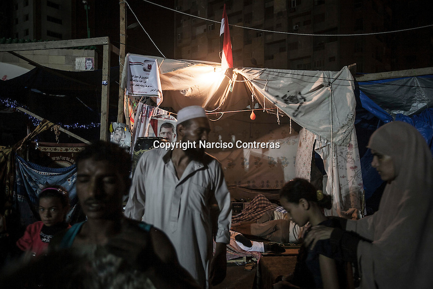 In this Thursday, Aug. 08, 2013 photo, supporters of the ousted president Mohammed Morsi are seen at the sit-in at Al-Raba'a Alawya in the Nasr district of Cairo. (Photo/Narciso Contreras).