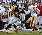 San Francisco 49ers defensive back Ronnie Heard (38) lines up to stop Oakland Raiders wide receiver Jerry Porter (84) on Sunday, November 3, 2002, in Oakland, California. The 49ers defeated the Raiders 23-20 in an overtime game.