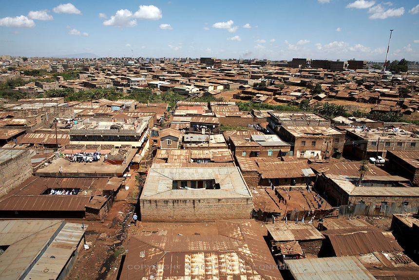 """The Korogocho slum in Nairobi, Kenya, on Monday, Jan. 12, 2009. Korogocho is third largest slum in Nairobi and has a population of approximately 250,000 with an average of 5-6 persons per room. The ITC (International Trade Center) and MAX&Co. work with communities from these areas to promote """"ethical fashion"""" which they hope will  """"make a tangible contribution to those who live in marginal conditions and hardship."""""""