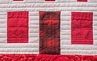 NWA Democrat-Gazette/ANTHONY REYES @NWATONYR<br /> The &quot;Farm Girl Goes Red and White&quot; quilt, shows curtains and a flower box on the window as well as the outline of a door on a quilt Monday, April 3, 2017 at the Shiloh Museum in Springdale.