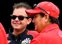 Sept. 1, 2013; Clermont, IN, USA: NHRA top fuel dragster driver Billy Torrence (right) talks with his son Steve Torrence during qualifying for the US Nationals at Lucas Oil Raceway. Mandatory Credit: Mark J. Rebilas-