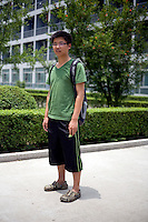 Lixuezhen, a student, age 22, poses for a portrait in Nanjing. Response to 'What does China mean to you?': 'China is a nation, my home country. I really like China. It has it's own position in the international arena. A position that cannot be diminished. Currently it is in a state of excellent development.'  Response to 'What is your role in China's future?': 'I want to be a good citizen, love my country, defend my country to the best of my knowledge, and be a good citizen.'