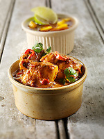Chicken Jalfrezi, pilau rice & popodoms. Indian traditional curry.